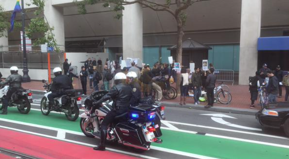 Police Officers present along with Protesters at the Uber Headquarters. Photo Courtesy Tracy Garza @tracygarza
