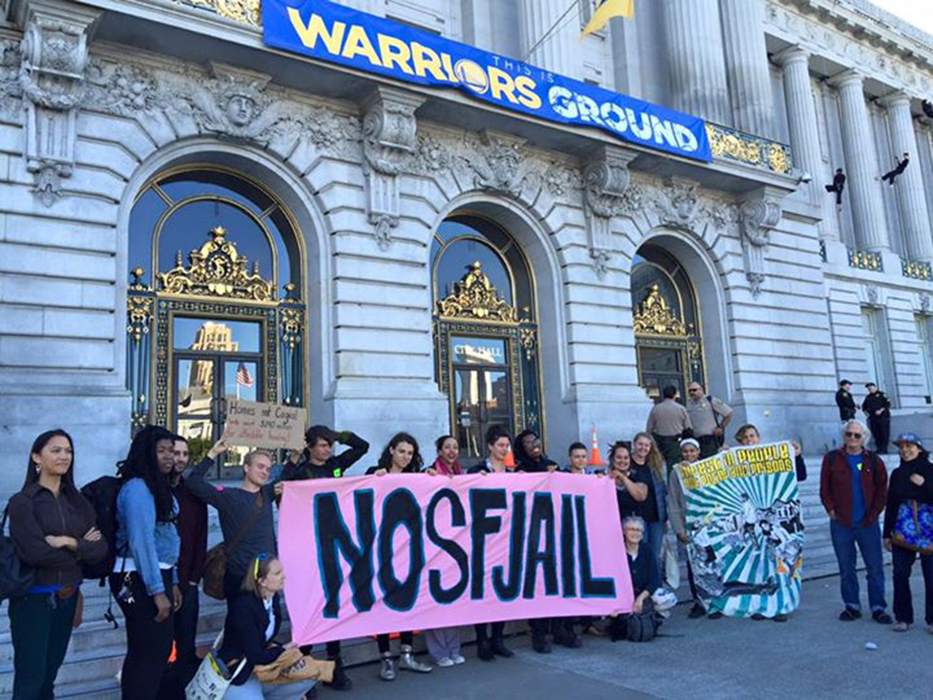 San Francisco locals protest the construction of a new jail in front of City Hall. The San Francisco News