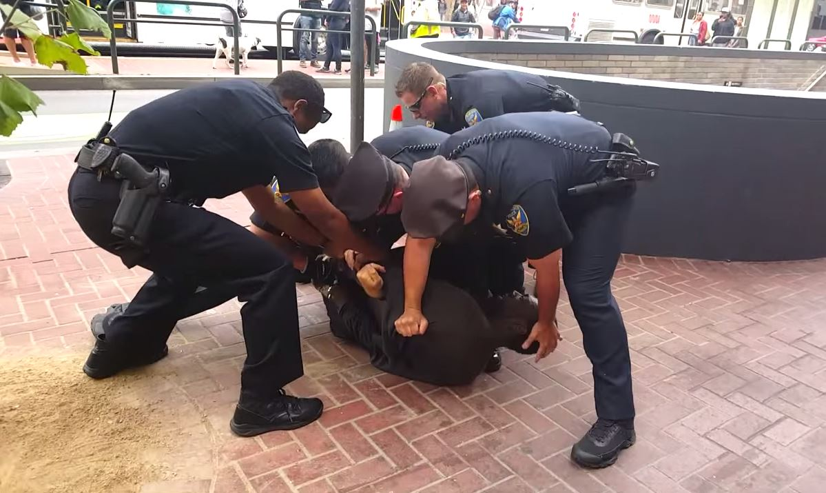 A still captured of SFPD officers pinning a disabled man to the ground after mistaking his crutches for weapons. Image courtesy of Chaédria LaBouvier