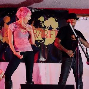 Deaf actress TL Forsberg and dancer Shaheem Sanchez perform together at an ASL Cabaret at Cafe NELO in September 2014.