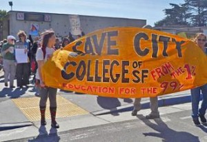 Students of CCSF raise a banner to protest the school's loss of accreditation.