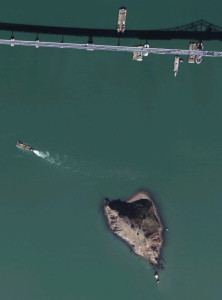 A shot of Red Rock Island from above in close proximity to Richmond-Rafael Bridge.