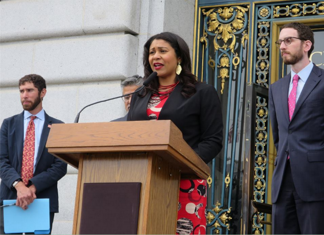 Board of Supervisors President London Breed speaks in front of City Hall