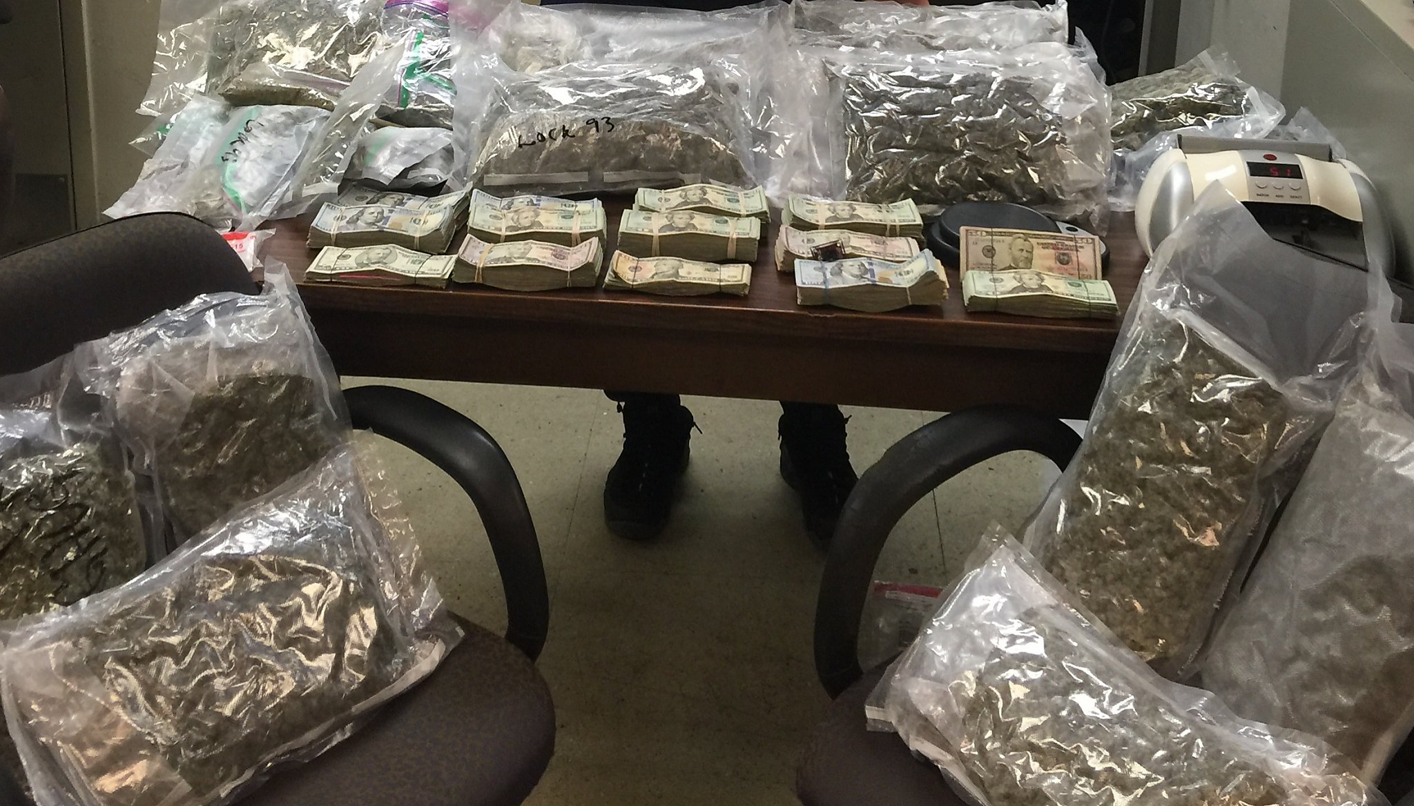 A picture of 10 lbs of confiscated marijuana and $10,000 found in relation to Jerome Weitz' national drug smuggling operation.