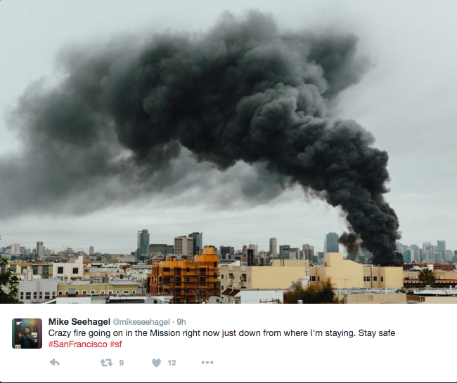 Thick black smoke rises from the Mission District . Photo by Mike Seehagel @mikeseehagel  via Twitter.