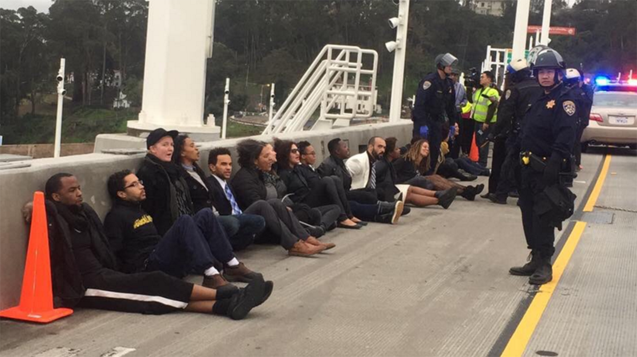 Black.Seed protesters gather to demonstrate in honor of Dr. Martin Luther King Jr. and rally against police brutality.