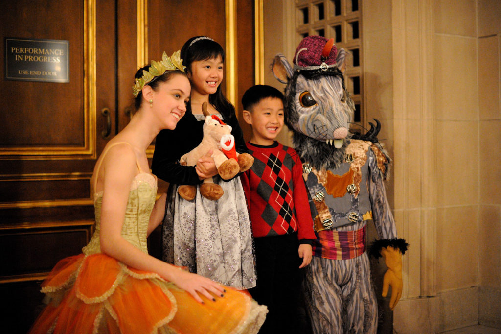 A photo taken with two cast members before the showing of Nutcracker on a family performance night.