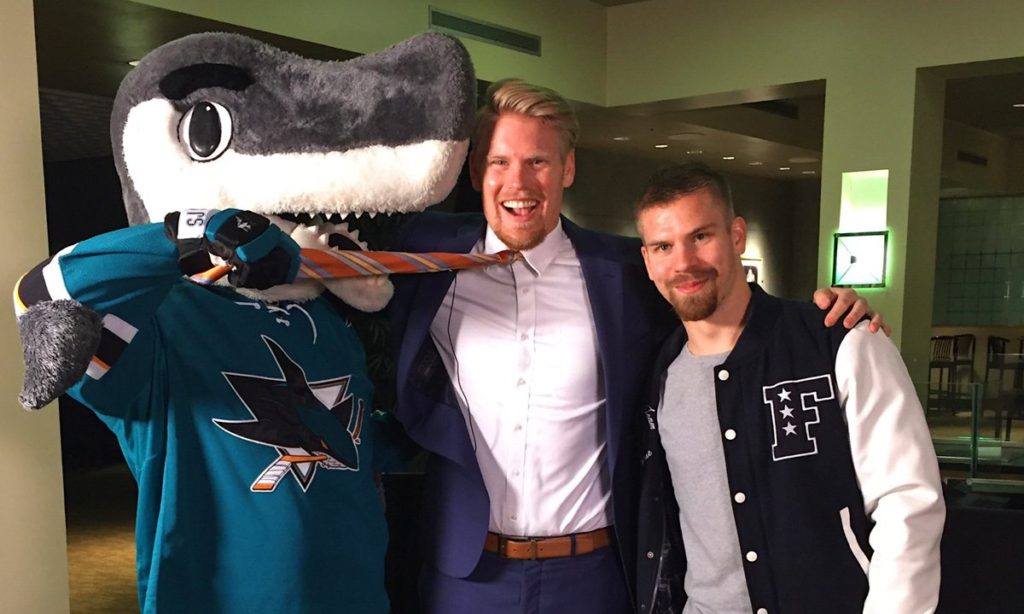 Donskoi (right) with the team's mascot, SJ Sharkie, and in-arena host Jon Root