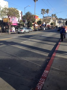 The SFPD, seen at a distance, are present at Mission and 24th street