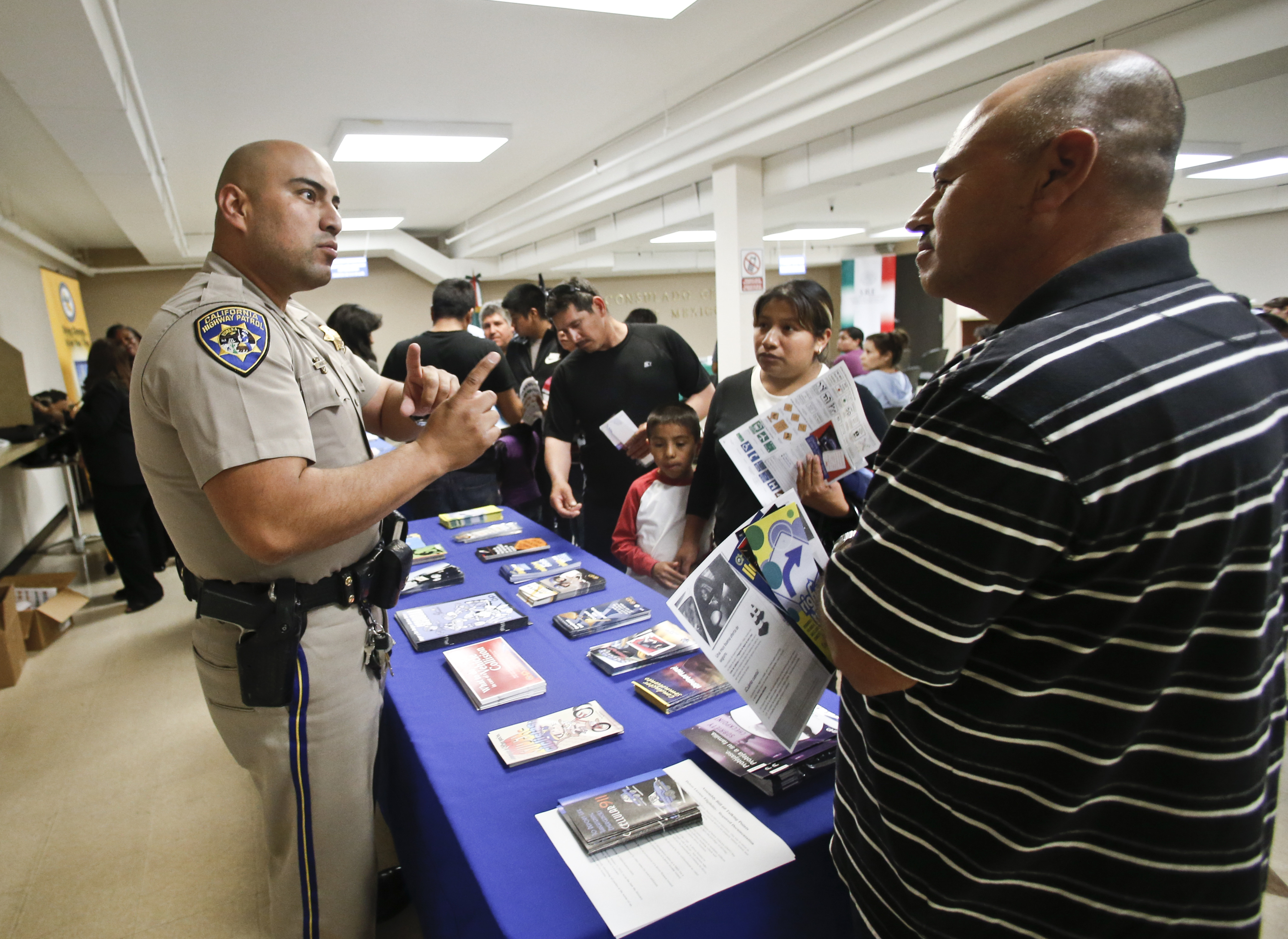 California Highway Patrol officer Armando Garcia explains to immigrants the process of getting a drivers license during an information session at the Mexican Consulate, in San Diego. Photo by Lenny Ignelz, AP The San Francisco News