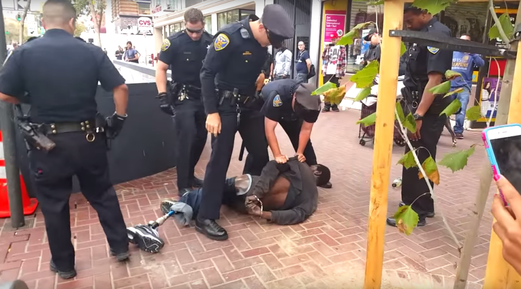 SFPD officers were criticized for a scuffle with a disabled man while attempting to handcuff him.<br>Image courtesy of footage provided by Chaédria LaBouvier.