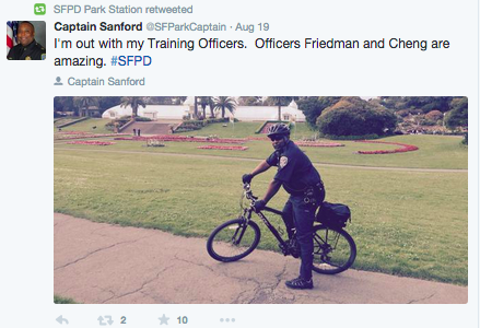 Captain John Sanford riding his bike to discuss local traffic policies with protestors. <br>Photo courtesy of Captain Sanford @SFParkCaptain via Twitter.