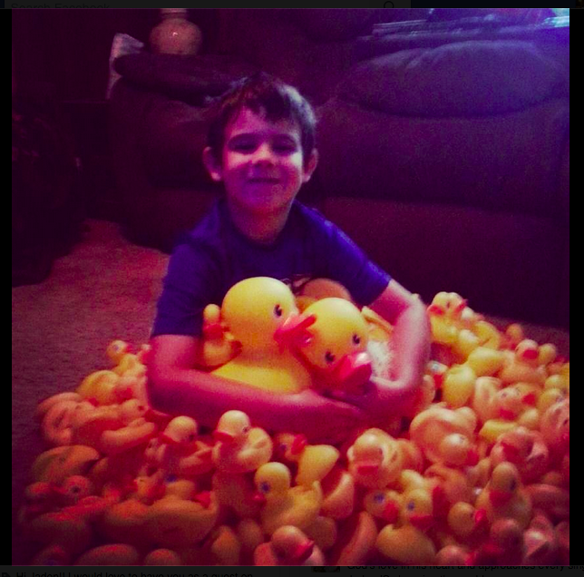 Jaden Hayes, 6, sits with a large donation of rubber duckies from Samantha Sahi.<br>Photo courtesy of Tasha Compton @mstashers via Instagram