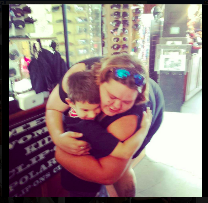 Jaden Hayes, 6, gets a hug from a woman who received a gift from Jaden's Smile Project.Photo courtesy of Tasha Compton @mstashers via Instagram