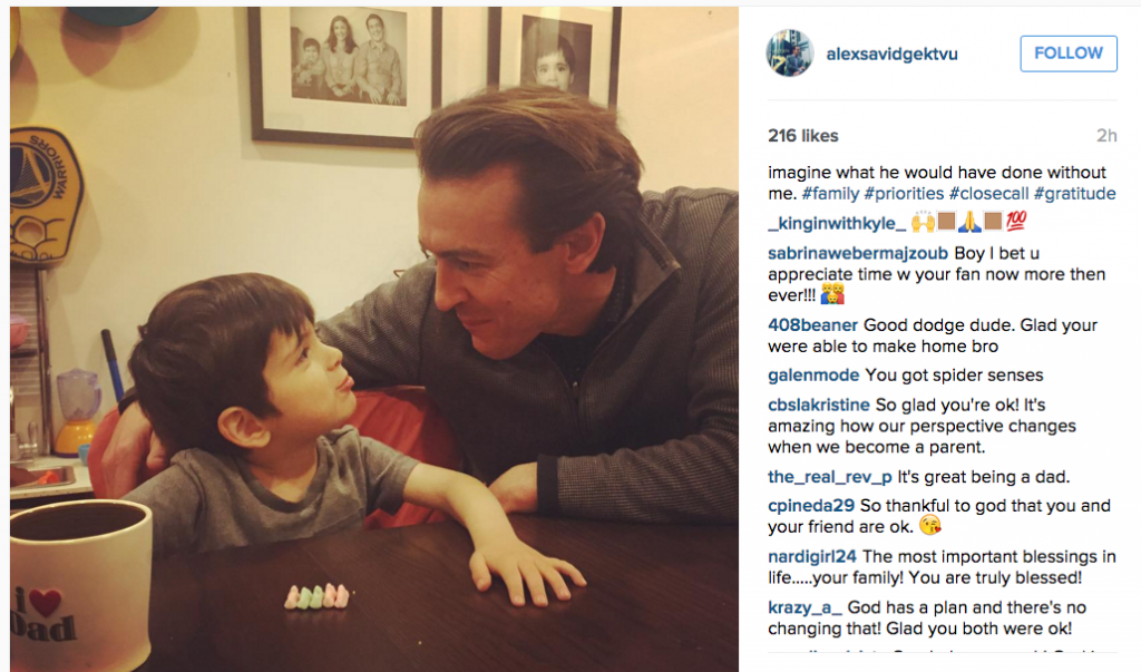 Alex Savidge posts a picture with his son after nearly being struck by a car while reporting.