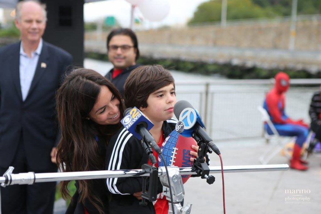Pietro Scarso, 7, and Samantha Altilio, 28, executive director of Pietro's Fight celebrate the FDA's announcement to approve Eteplirsen, the first drug ever made available to patients with Duchenne muscular dystrophy.