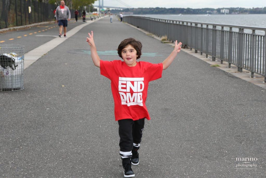 Pietro Scarso, 7, crosses the finish line to celebrate the FDA's announcement of the approval of Eteplirsen, the first drug ever made available to patients with Duchenne muscular dystrophy.